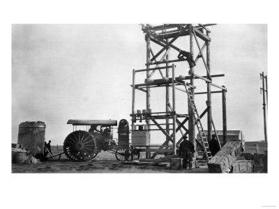 Electric Plant Construction & Old Tractor - Stanford, MT-Lantern Press-Framed Art Print
