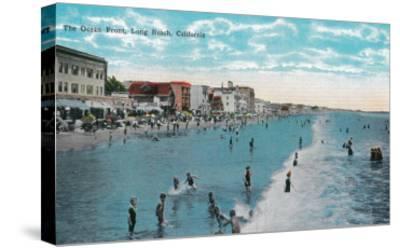 Enjoying Waves at Ocean Beach - Long Beach, CA-Lantern Press-Stretched Canvas Print