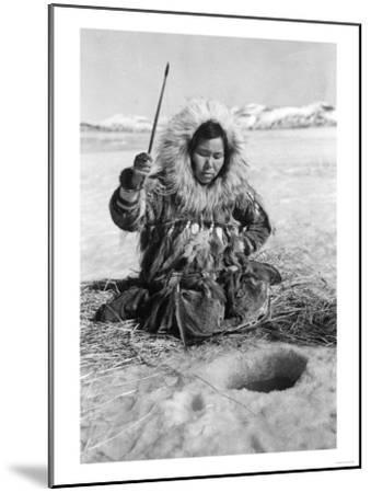 Eskimo Woman Fishing through Ice in Alaska Photograph - Alaska-Lantern Press-Mounted Art Print