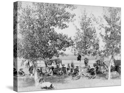 Cowboys Eating Dinner on Ground Under Trees Photograph - South Dakota-Lantern Press-Stretched Canvas Print