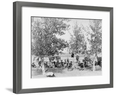 Cowboys Eating Dinner on Ground Under Trees Photograph - South Dakota-Lantern Press-Framed Art Print