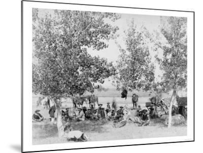 Cowboys Eating Dinner on Ground Under Trees Photograph - South Dakota-Lantern Press-Mounted Art Print