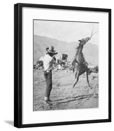 Cowboy Holds Rope around Struggling Bronco's Neck Photograph - Texas-Lantern Press-Framed Art Print