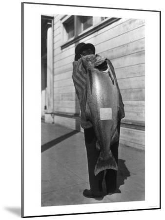 View of a Huge Salmon on Man's Back - Smith River, CA-Lantern Press-Mounted Art Print