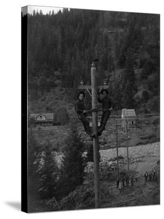 View of Electricians Fixing Wired Pole - Sawyers Bar, CA-Lantern Press-Stretched Canvas Print