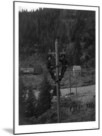 View of Electricians Fixing Wired Pole - Sawyers Bar, CA-Lantern Press-Mounted Art Print