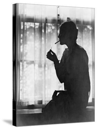Silhouette of Woman Lighting Cigarette Photograph - New York, NY-Lantern Press-Stretched Canvas Print