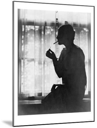 Silhouette of Woman Lighting Cigarette Photograph - New York, NY-Lantern Press-Mounted Art Print
