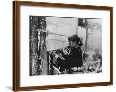 Navajo Woman Weaving a Blanket Photograph-Lantern Press-Framed Art Print