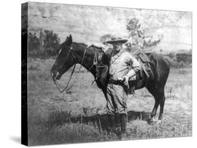 Theodore Roosevelt Dressed as Cowboy next to Horse Photograph - NA-Lantern Press-Stretched Canvas Print