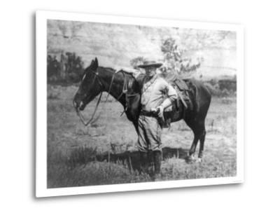 Theodore Roosevelt Dressed as Cowboy next to Horse Photograph - NA-Lantern Press-Metal Print