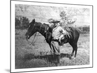 Theodore Roosevelt Dressed as Cowboy next to Horse Photograph - NA-Lantern Press-Mounted Art Print