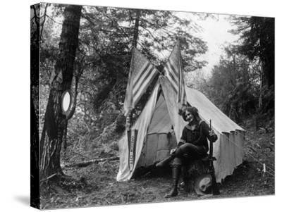 Woman with Gun Sitting Outside Her Tent Fourth of July - Thompson Creek, OR-Lantern Press-Stretched Canvas Print