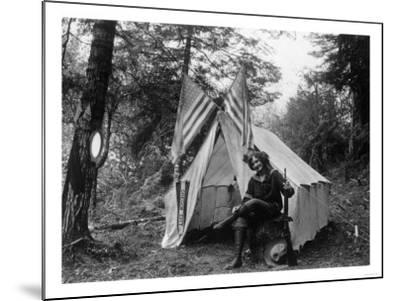 Woman with Gun Sitting Outside Her Tent Fourth of July - Thompson Creek, OR-Lantern Press-Mounted Art Print