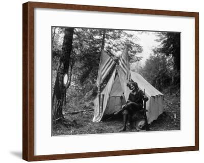 Woman with Gun Sitting Outside Her Tent Fourth of July - Thompson Creek, OR-Lantern Press-Framed Art Print