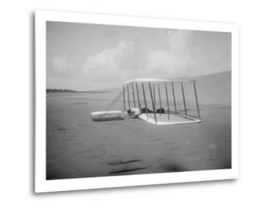 Wilbur Wright in prone position on glider Photograph - Kitty Hawk, NC-Lantern Press-Metal Print
