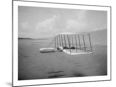 Wilbur Wright in prone position on glider Photograph - Kitty Hawk, NC-Lantern Press-Mounted Art Print