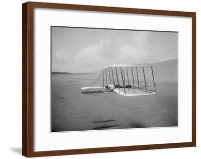 Wilbur Wright in prone position on glider Photograph - Kitty Hawk, NC-Lantern Press-Framed Art Print