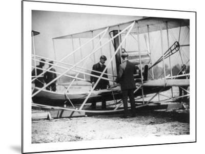 Wilbur Wright with Canoe attached to Plane Photograph - New York-Lantern Press-Mounted Art Print