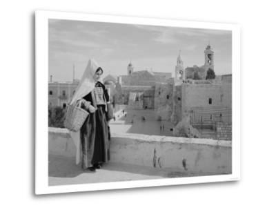 Woman on Roof Facing Church of the Nativity Photograph - Bethlehem, Palestine-Lantern Press-Metal Print