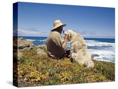 Man and His Italian Sheep Dog Sit Overlooking the Ocean-Jason Edwards-Stretched Canvas Print