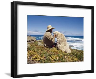 Man and His Italian Sheep Dog Sit Overlooking the Ocean-Jason Edwards-Framed Photographic Print