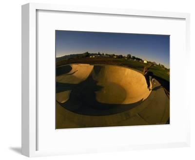Skateboarding in a Skate Park-Bill Hatcher-Framed Photographic Print