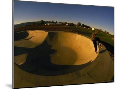 Skateboarding in a Skate Park-Bill Hatcher-Mounted Photographic Print