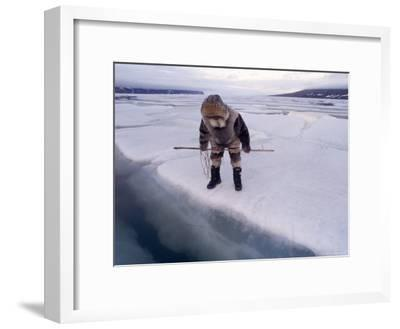 An Inuit Hunter Waits For Seals on an Ice Floe-Gordon Wiltsie-Framed Photographic Print