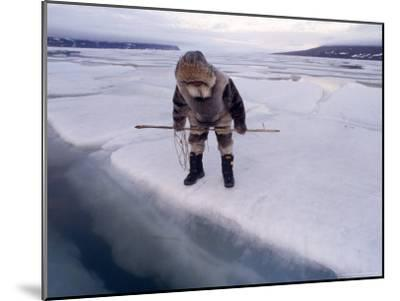An Inuit Hunter Waits For Seals on an Ice Floe-Gordon Wiltsie-Mounted Photographic Print