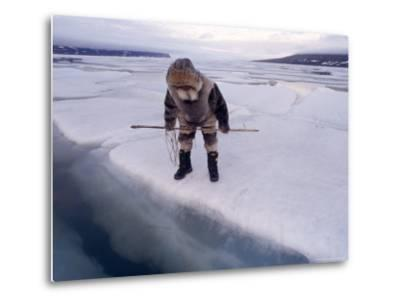 An Inuit Hunter Waits For Seals on an Ice Floe-Gordon Wiltsie-Metal Print