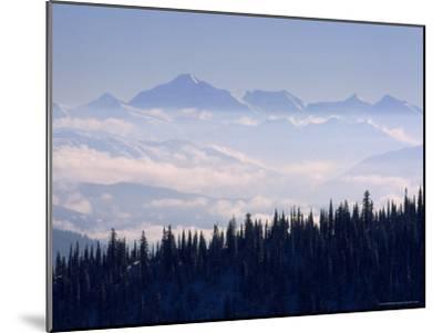 Clouds Envelope the Rocky Mountains Near Whitefish-Gordon Wiltsie-Mounted Photographic Print