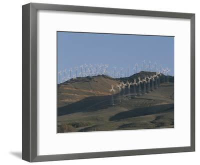 Rows of Spinning Wind Turbines Generate Electricity-Marc Moritsch-Framed Photographic Print