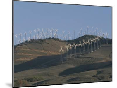 Rows of Spinning Wind Turbines Generate Electricity-Marc Moritsch-Mounted Photographic Print
