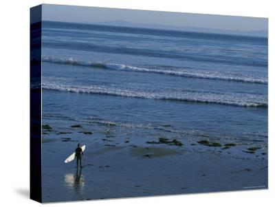 Longboard Surfer Watches the Surf Break on an Isla Vista Beach-Rich Reid-Stretched Canvas Print