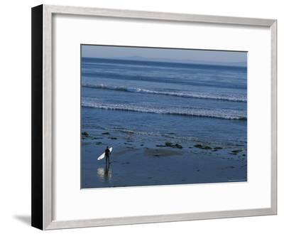 Longboard Surfer Watches the Surf Break on an Isla Vista Beach-Rich Reid-Framed Photographic Print