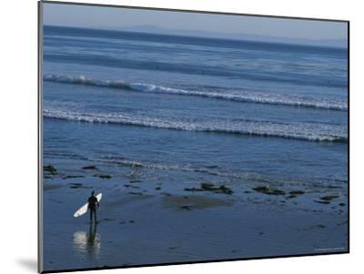 Longboard Surfer Watches the Surf Break on an Isla Vista Beach-Rich Reid-Mounted Photographic Print