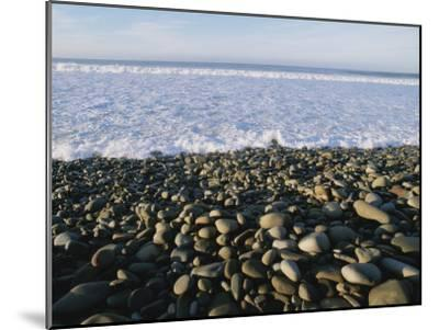Whitewater From Crashing Waves Washes onto a Pebble Beach-Rich Reid-Mounted Photographic Print