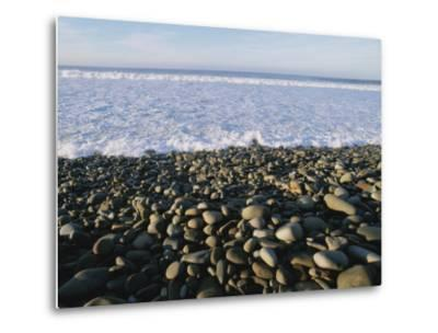 Whitewater From Crashing Waves Washes onto a Pebble Beach-Rich Reid-Metal Print