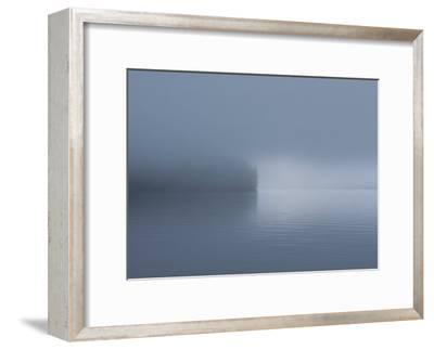 Thick Fog Hangs Over Eerily Calm Water Where a Point of Land Juts Out-Bill Curtsinger-Framed Photographic Print