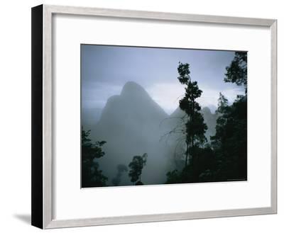 Peak of Gunung Budda Through Early Morning Fog-Stephen Alvarez-Framed Photographic Print