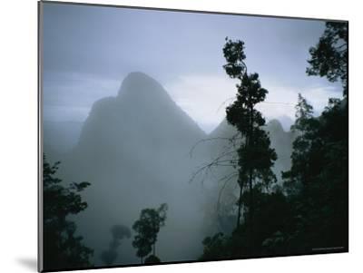 Peak of Gunung Budda Through Early Morning Fog-Stephen Alvarez-Mounted Photographic Print