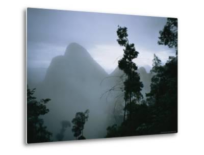Peak of Gunung Budda Through Early Morning Fog-Stephen Alvarez-Metal Print