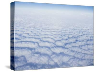 Cloud Pattern over the Pacific Ocean at 30,000 Feet-Rich Reid-Stretched Canvas Print