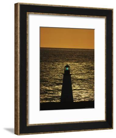 Illuminated Silhouetted Lighthouse at Sunset-Michael Melford-Framed Photographic Print