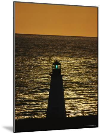 Illuminated Silhouetted Lighthouse at Sunset-Michael Melford-Mounted Photographic Print