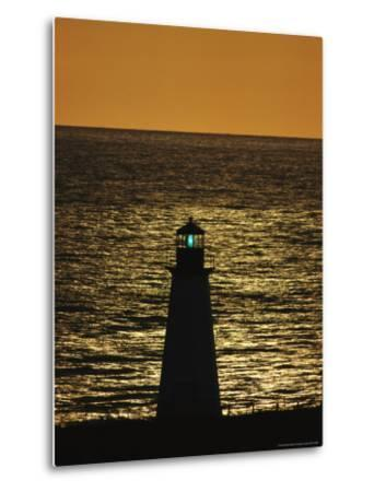 Illuminated Silhouetted Lighthouse at Sunset-Michael Melford-Metal Print