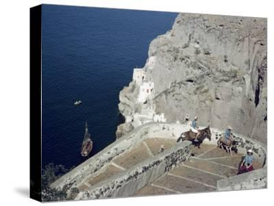 Donkeys Carry Visitors From the Ocean To the Hilltop Town of Thera-Maynard Owen Williams-Stretched Canvas Print