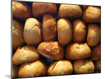 Wall of Fresh-Baked Loaves of Bread Awaits Buyers at the Bakery-Stephen St^ John-Mounted Photographic Print