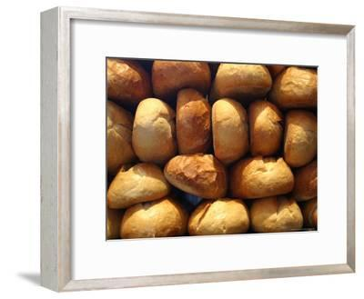 Wall of Fresh-Baked Loaves of Bread Awaits Buyers at the Bakery-Stephen St^ John-Framed Photographic Print